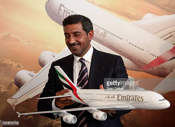 Sheikh Ahmed bin Saeed Al Maktoum Chairman of Emirates airline holds a model of an Airbus A380 passenger plane while attending a press conference at...