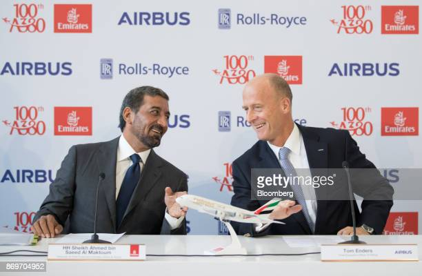 Sheikh Ahmed bin Saeed Al Maktoum chief executive officer of Emirates Airlines left and Tom Enders chief executive officer of Airbus SE react during...