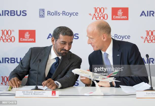 Sheikh Ahmed bin Saeed Al Maktoum chief executive officer of Emirates Airlines left and Tom Enders chief executive officer of Airbus SE talk during a...
