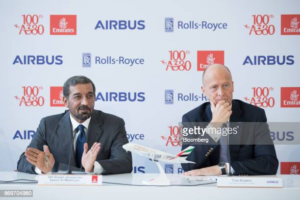 Sheikh Ahmed bin Saeed Al Maktoum chief executive officer of Emirates Airlines left speaks as Tom Enders chief executive officer of Airbus SE looks...