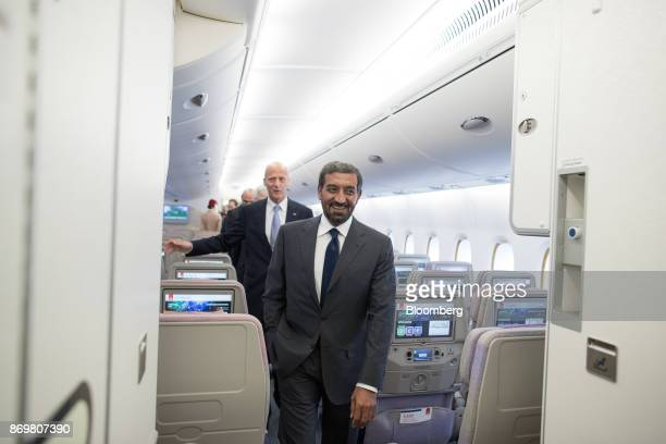 Sheikh Ahmed bin Saeed Al Maktoum chief executive officer of Emirates Airlines right and Tom Enders chief executive officer of Airbus SE walk down...