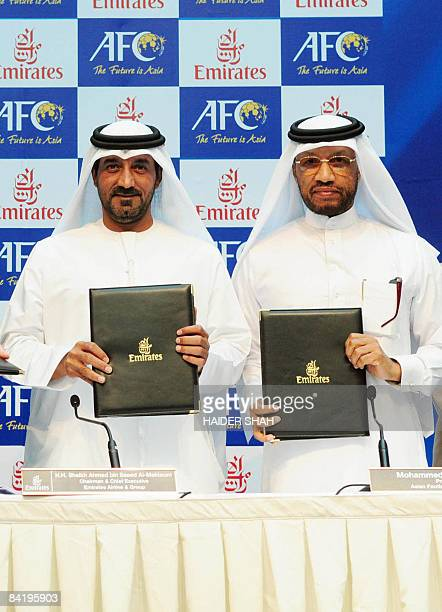 Sheikh Ahmed bin Saeed alMaktoum Chairman and Chief Executive of Emirates Airlines and AFC President Mohammed bin Hammam pose during a press...
