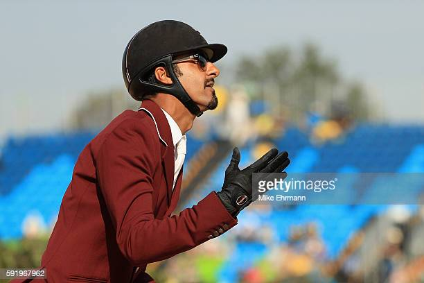 Sheikh Ali Al Thani of Qatar riding First Devision reacts after competing during the Equestrian Jumping Individual Final Round on Day 14 of the Rio...