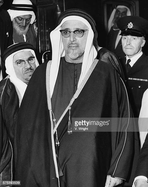 Sheikh Ali Bin Abdullah Al Thani the ruler of Qatar flanked by his aides and policemen as he arrives at Victoria Station during a visit to London...