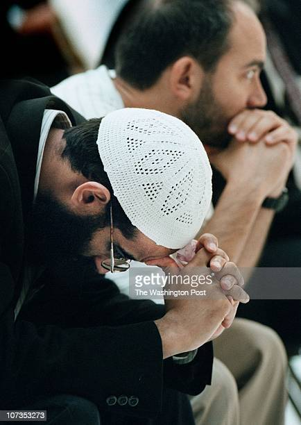 Sheikh Anwar AlAwlaki the Imam of the Dar Al Hijrah muslim mosque in Falls Church prays during a community press conference/ prayer service at the...