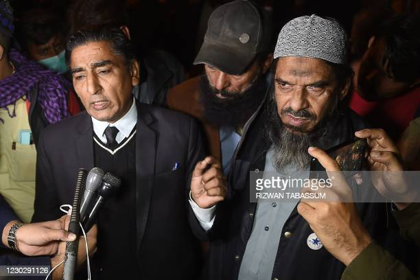 Sheikh Aslam , a relative of one of the accused of murdering US journalist Daniel Pearl and his lawyer Nadeem Azhar speak with media representatives...