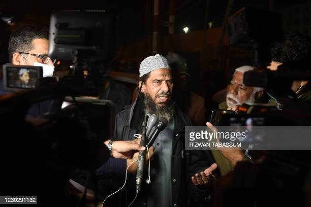 Sheikh Aslam, a relative of one of the accused of murdering US journalist Daniel Pearl, speaks with media representatives outside a prison in Karachi...