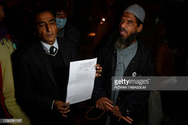 Sheikh Aslam , a relative of one of the accused of murdering US journalist Daniel Pearl, speaks with media representatives along with his lawyer...