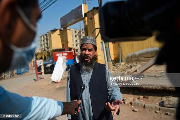 Sheikh Aslam, brother ofSheikhAdil, one of the accused of murdering US journalist Daniel Pearl, speaks with media representatives outside the...