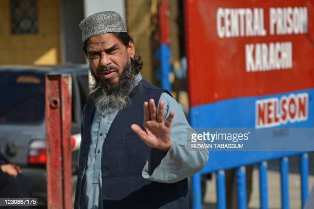Sheikh Aslam, brother ofSheikhAdil, one of the accused of murdering US journalist Daniel Pearl, gestures as he walks out from the central prison...