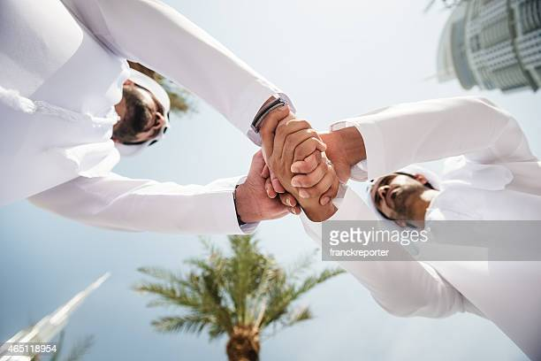 sheikh doing a deal in uae - images stock pictures, royalty-free photos & images