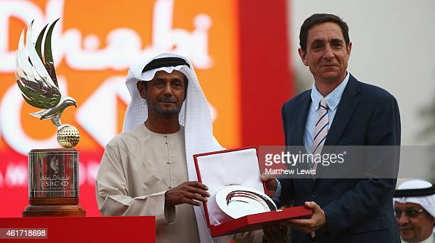 Sheikh Fahim Bin Sultan Al Qasimi presents a silver salver to Miguel Vidaor European Tour tournament director after day four of the Abu Dhabi HSBC...
