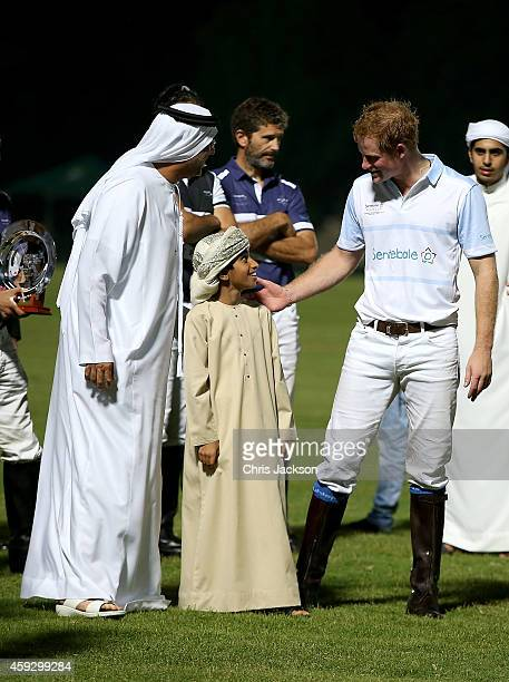 Sheikh Falah bin Zayed Bin Sultan Al Nahyan and son with Prince Harry during the prizegiving of the Sentebale Polo Cup presented by Royal Salute...