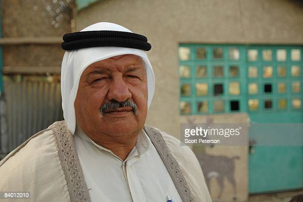 Sheikh Fayeq alTaee an Iraqi Shiite and the head of the AlSahwa tribe stands for a portrait at his farm on the northern outskirts of Baghdad Iraq on...