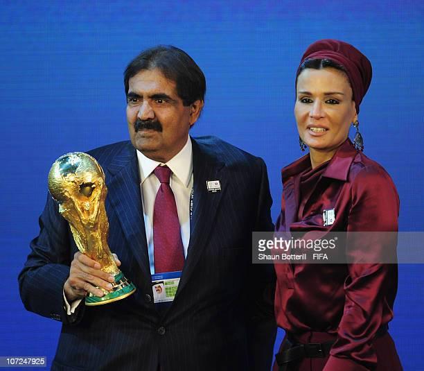 Sheikh Hamad bin Khalifa Al Thani and HH Sheikha Moza bint Nasser AlMissned hold the trophy after the annoucement that Qatar had won the bid for the...