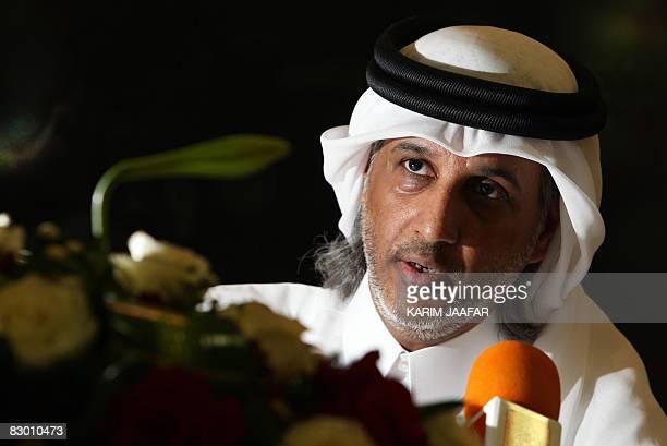 Sheikh Hamad bin Khalifa bin Ahmed alThani president of Qatar's Football Federation poses after ormer United Arab Emiartes national football team...