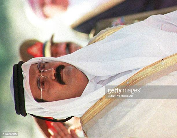 Sheikh Hamad ibn Khalifa alThani emir of Qatar shown arriving at the Muscat airport in Oman 04 December 1995