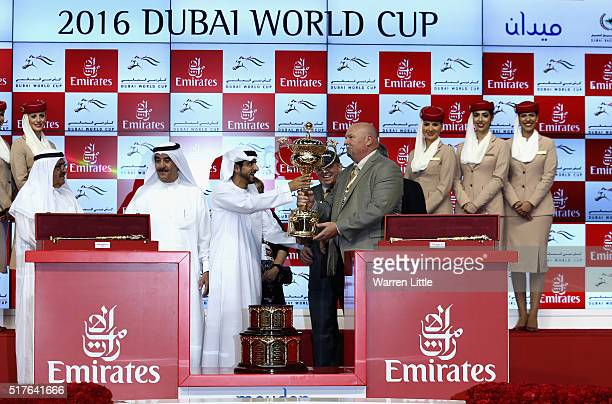 Sheikh Hamdan bin Mohammed bin Rashid Al Maktoum presents the World Cup to the team of California Chrome after winning the Dubai World Cup Sponsored...