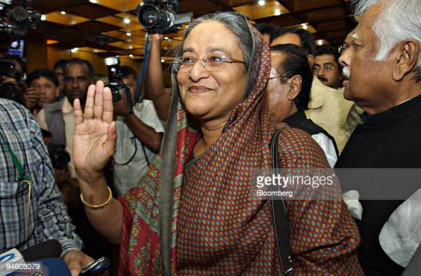 Sheikh Hasina Wajed a former Bangladesh prime minister and opposition leader waves to the media as she arrives at Zia International Airport in Dhaka...