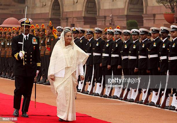 Sheikh Hasina Wajed Bangladesh's prime minister inspects an honor guard upon her arrival to the Indian presidential palace in New Delhi India on...