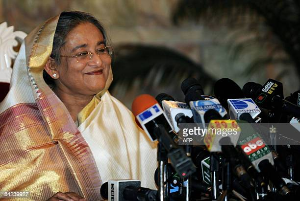 Sheikh Hasina Wajed smiles as she addresses a press conference after being sworn in for her second spell as prime minister of Bangladesh at the...