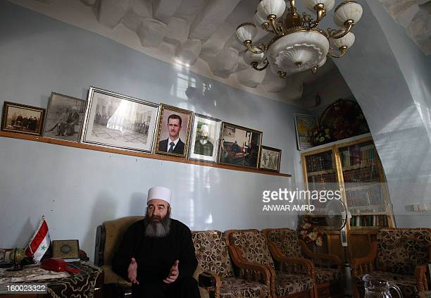 Sheikh Hikmat Hajari, a top Druze cleric, sits in his home in the southern city of Sweida on January 23, 2013. Abductions of Druze officials in Daraa...