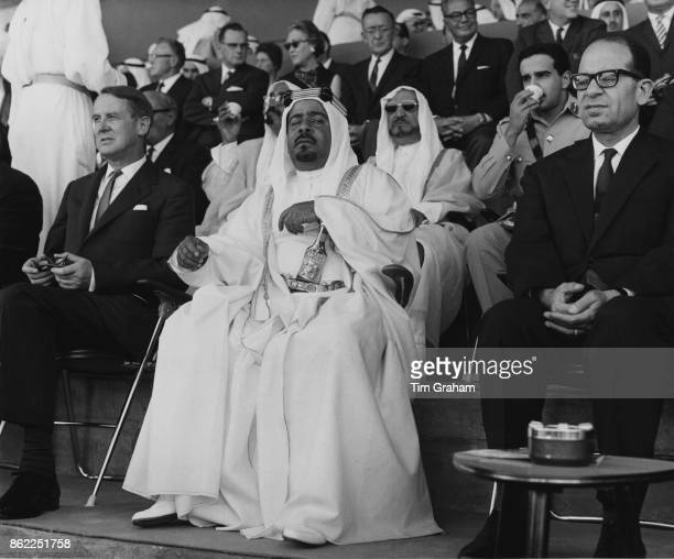 Sheikh Isa bin Salman Al Khalifa the emir of Bahrain watches the inauguration ceremonies for Isa Town a new town in Bahrain with Sir Stewart Crawford...