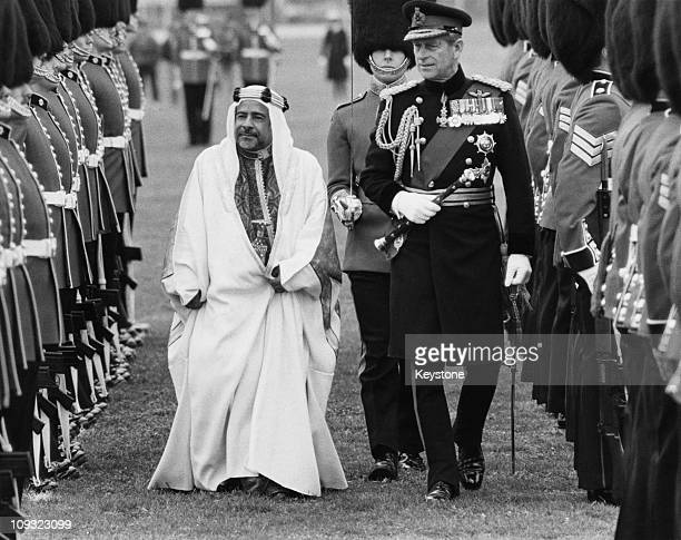 Sheikh Isa ibn Salman Al Khalifa the Emir of Bahrain inspects the Guard of Honour at Windsor during a State Visit to the UK 10th April 1984 He is...