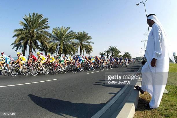Sheikh Khaled Bin Ali al-Thani head of Qatar Cycling Federation watches the first Doha International Grand Prix in Doha 31 January 2004. Italian...