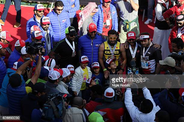 Sheikh Khaled bin Hamad Al Khalifa poses for pictures after finishing the Ironman 70.3 Middle East Championship Bahrain on December 10, 2016 in...