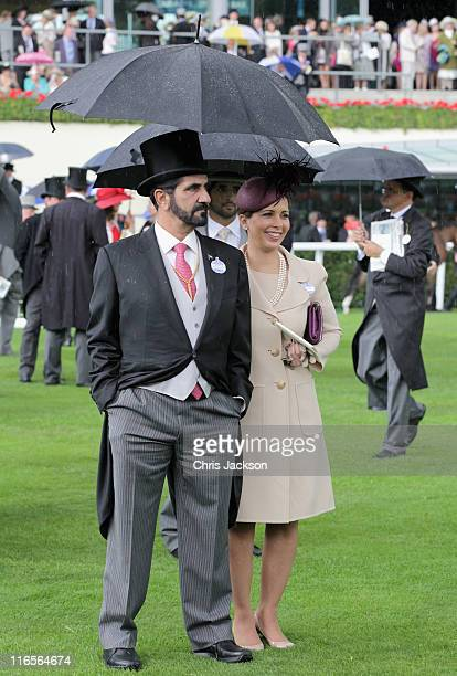 Sheikh Maktoum bin Rashid Al Maktoum and Princess Haya Bint Al Hussein look at horses in the parade ring on Ladies Day at Royal Ascot at Ascot...