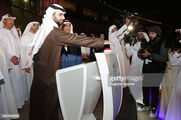 Sheikh Mansoor bin Mohammed Al Maktoum pushes the button to inaugurate the launch of Imagine A Show Like No Other Dubai Festival City at Festival Bay...