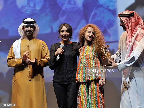 HH Sheikh Mansoor bin Mohammed bin Rashid Al Maktoum director Haifaa Al Mansour and actress Waad Mohammed on stage during the Closing Ceremony on day...