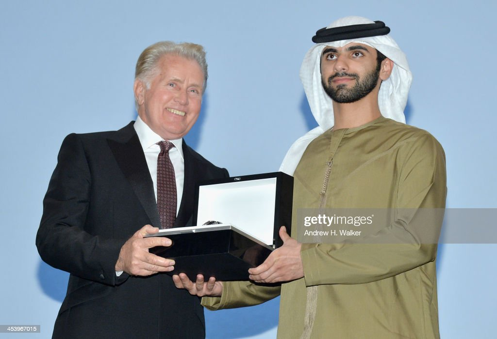Sheikh Mansoor bin Mohammed bin Rashid Al Maktoum presents Martin Sheen with his Lifetime Achievement award on stage at the Opening Night Gala of the 10th Annual Dubai International Film Festival held at the Madinat Jumeriah Complex on December 6, 2013 in Dubai, United Arab Emirates.