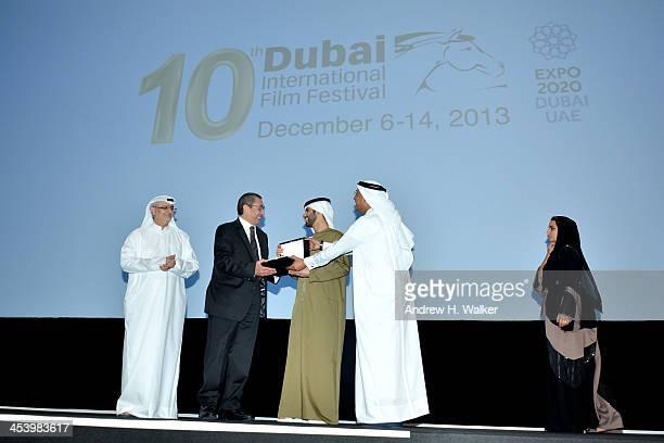 Sheikh Mansoor bin Mohammed bin Rashid Al Maktoum presents Samir Farid with his Lifetime Achievement award on stage with Artistic Director of DIFF...