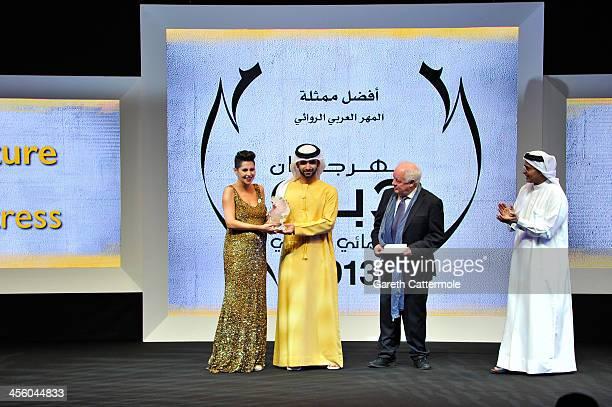 Sheikh Mansoor bin Mohammed bin Rashid Al Maktoum presents Yasmine Raees with her Arab Feature Best Actress award with Jim Sheridan and DIFF Chairman...
