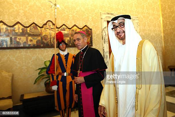 Sheikh Mohamed bin Zayed Al Nahyan Crown Prince of Abu Dhabi and Deputy Supreme Commander of the UAE Armed Forces flanked by Prefect of the...