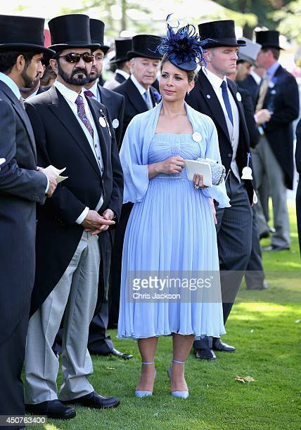 Sheikh Mohammed bin Rashid Al Maktoum and Princess Haya bint Al Hussein attend day one of Royal Ascot at Ascot Racecourse on June 17 2014 in Ascot...