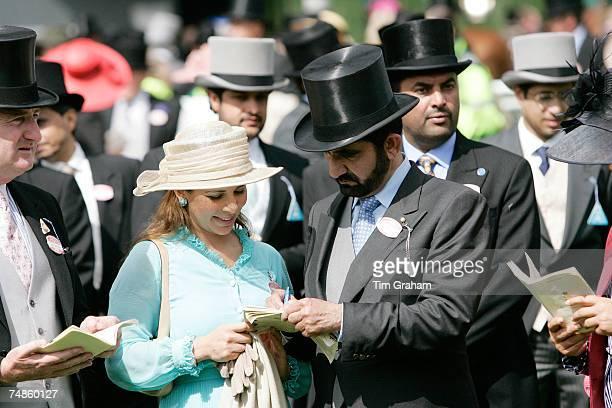 Sheikh Mohammed Bin Rashid Al Maktoum, ruler of Dubai, and Princess Haya Bint Al Hussein view the racing programme during the fourth day of Royal...