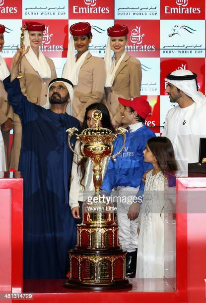 Sheikh Mohammed bin Rashid Al Maktoum, Ruler of Dubai and Vice President of the UAE rejoices after winning the Dubai World Cup with his horse African...