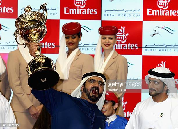 Sheikh Mohammed bin Rashid Al Maktoum, Ruler of Dubai and Vice President of the UAE rejoices as he wins the Dubai World Cup with his horse African...