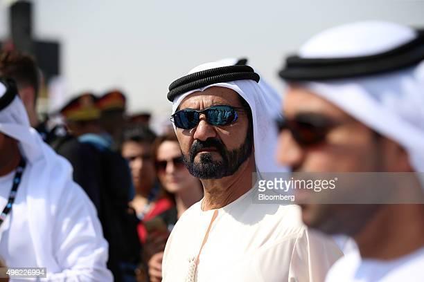 Sheikh Mohammed bin Rashid Al Maktoum the ruler of Dubai center tours the 14th Dubai Air Show at Dubai World Central on its opening day in Dubai...