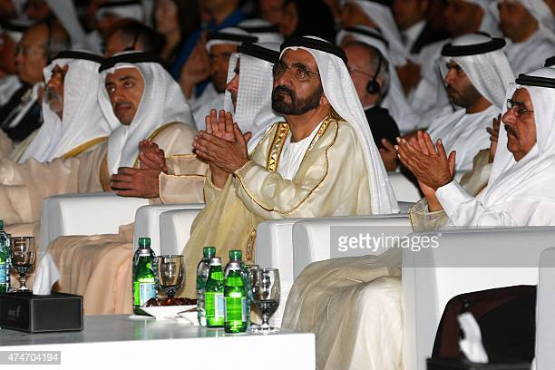 Sheikh Mohammed bin Rashid alMaktoum Prime Minister of the United Arab Emirates and ruler of Dubai applauds during the presentation of the UAE Space...