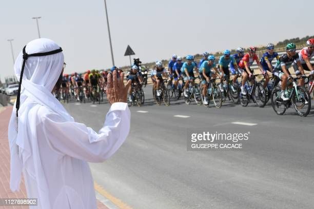 Sheikh Mohammed bin Rashid al-Maktoum, Vice-President and Prime Minister of the UAE and Ruler of Dubai, greets cyclists during the fourth stage of...