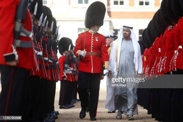Sheikh Mohammed bin Zayed Al Nahyan, Crown Prince of Abu Dhabi inspects a Guard of Honour by the Grenadier Guards on September 16, 2021 in London,...