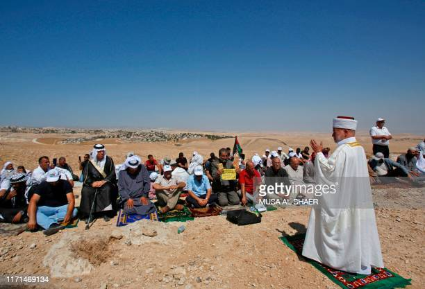 Sheikh Mohammed Hussein the Grand Mufti of Jerusalem leads Friday prayers held during a Palestinian demonstration against Israeli settlers laying...