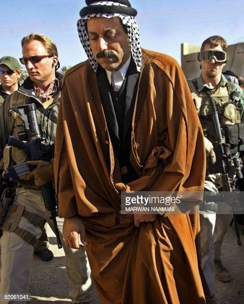 Sheikh Muthana Hatem chief of Bani Hassan Tribe an independent election candidate is escorted by two US gurads as he enters reception room to meet...