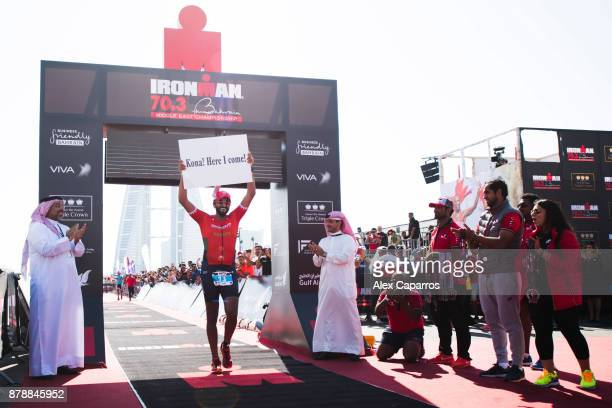 Sheikh Nasser Bin Hamad Al Khalifa celebrates finishing the men's race of IRONMAN 703 Middle East Championship Bahrain on November 25 2017 in Bahrain...
