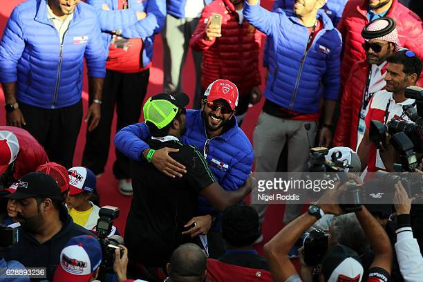 Sheikh Nasser bin Hamad Al Khalifa greets an athlete after finishing the Ironman 703 Middle East Championship Bahrain on December 10 2016 in Bahrain...