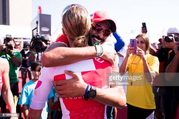 Sheikh Nasser Bin Hamad Al Khalifa is congratulated by Daniela Ryf of Switzerland after finishing the men's race of IRONMAN 703 Middle East...